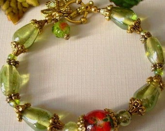 Green and Antiqued Gold Butterfly Charm Bracelet