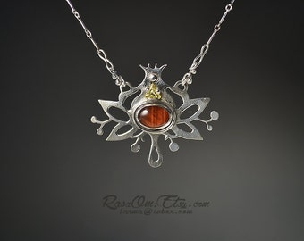 Lotus necklace handmade by RasaOm. Sterling silver.925 red tiger eye cabochon