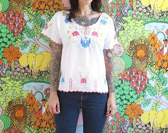 70s vintage embroidered white hippie blouse top with pink yellow and blue// medium