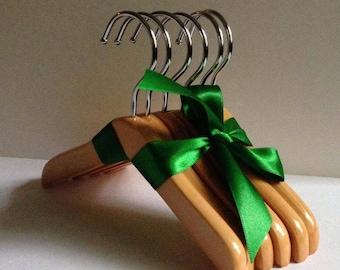 4 Bundles of 6 Wooden Doll Hangers