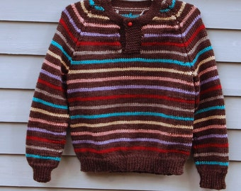 Boy, size 10/12, one button sweater in charcoal gray with multi colored stripes.