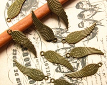 Bronze Wing Charms / Pendants - Set of 10 - Angel Wings - Antique Bronze Finish - 31 x 9mm (BC0007)