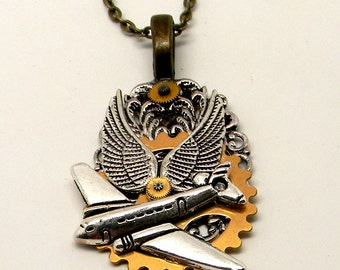 Steampunk angel wings and airplane necklace pendant. Steampunk jewelry.