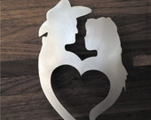 Western couple cake topper in natural steel.
