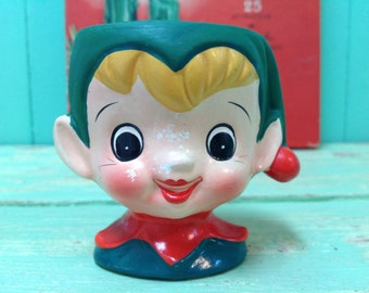 Jolly little elf candle holder