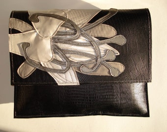 Handmade City Clutch in black snake embossed leather with pearlised cream Lily