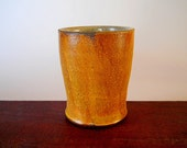 Small cup without a handle, soft hourglass shape, rusty orange colored slip, rustic-minimalist petite drinking cup, small tumbler