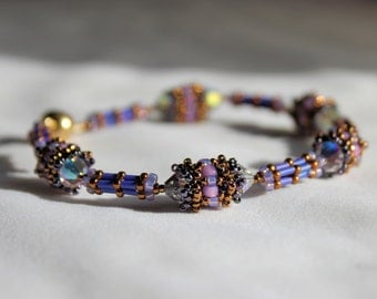 Hand beaded Bracelet  with beaded beads, in lavender and purple. Accented with 6mm Swarovski crystals