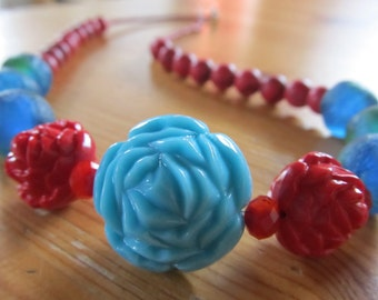 "STATEMENT NECKLACE -- ROSES  red and aqua acrylic, red howlite, recycled African glass, Czech glass (19"" in length)"