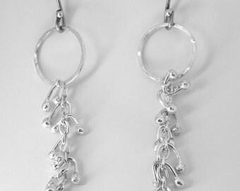 Sterling silver slender, long, luxurious kinetic earrings