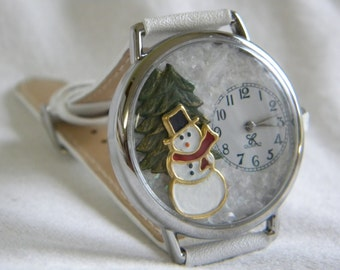 Snowman Watch with Evergreen Tree and Snowy Background