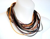 autumn colour | multi strand | tribal style rubber necklace | orange and black,
