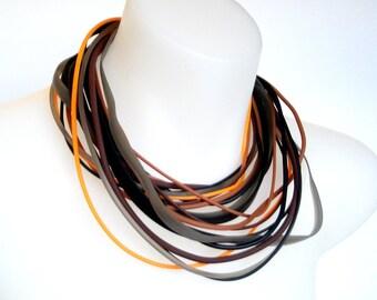 autumn colour | multi strand | tribal style rubber necklace | orange and black,