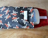 red black and white pirate diaper clutch skull and cross bones with red wood grain print inside