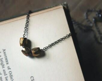 Gaslight. Faceted Bronze Czech Glass Bead and Gunmetal Necklace.
