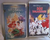 Reserved for MyGrandmasHome.2 VHS Movies,Walt Disney Classic.The Little Mermaid,original Animal adventure101 Dalmatians,Big happy Dog family