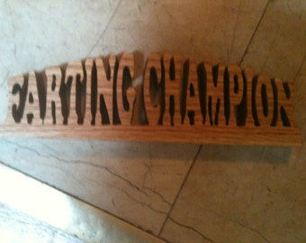 Wooden farting champion display