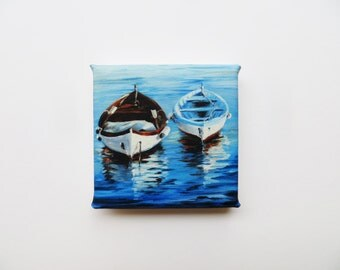 two rowboats in the water mini canvas print