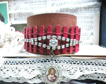 catholic bracelet cuff leather medal assemblage fence religious
