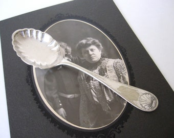 Antique Sugar Spoon Engraved Della, Shell by WM Rogers Silverplate