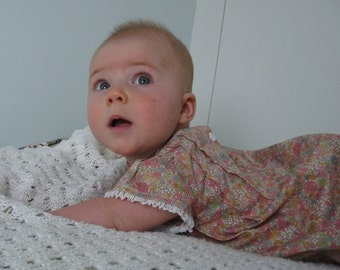 Pretty liberty lawn baby dress with matching bloomers. Age 6 months.