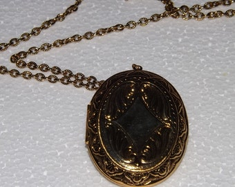Two Gold metal lockets