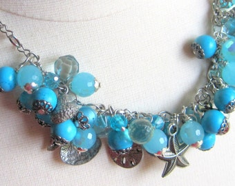 Luscious turquoise and faceted crystal beaded necklace with ocean inspired pewter charms