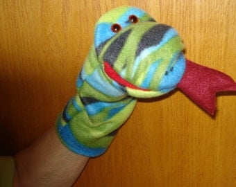 Snake hand puppet with  multi shades  of black, green, and blue with moveable mouth