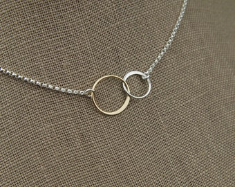 Interlocking rings necklace in sterling silver and bronze, two linked circles, interlocking circles, mixed metals, silver and bronze
