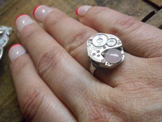 The Wife of Artemis Gordon. Steampunk watch part gear and Rose Quartz crystal ring