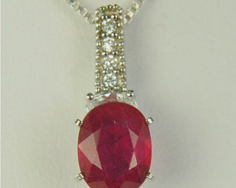 Ruby Necklace Sterling Silver 9x7mm 2ct With Round And Oval Cz's