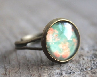 mint and rose flare. ring. (antique brass. cicle picture. magnifying globe. rust orange. mint green. flower. vintage floral wallpaper).