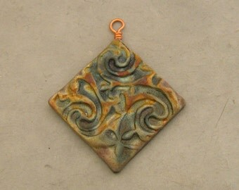 Ceramic Raku Pendant - Celtic Spirals Diamond