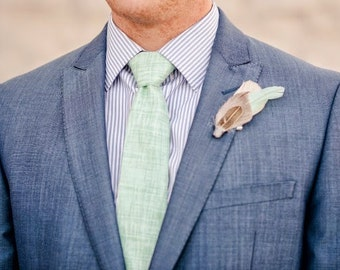 TOFINO Boutonniere in Aqua, Grey and Lightest Melon with Antique Brass Feather and Grey Wool Wrap