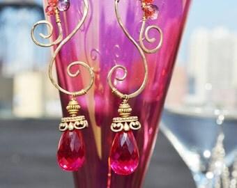 s-shaped red topaz dangle earrings...