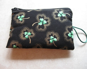 green shamrocks with gold padded makeup jewelry bag
