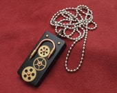 Steampunk jewelry, domino necklace, cogs and gears