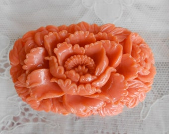 1930's Tangerine Celluloid Floral PIn
