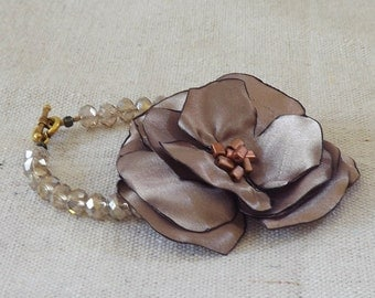Shimmery Beaded Bracelet with Taupe Satin Flower