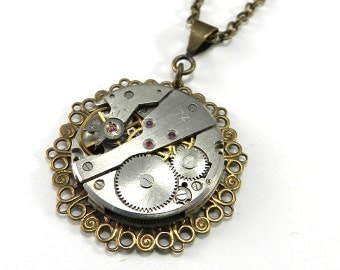 SALE Steampunk Necklace - Watch Mechanism Pendant on Gold Filigree Pendant by Compass Rose Design