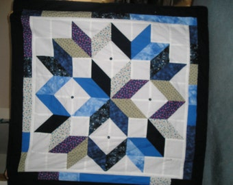 Star pattern blanket featuring shades of blue, mauve, cream