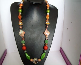 Hot tango necklace with mixed green and orange glass and plastic beads