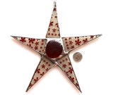Ann Star- 7 inch red floral motif on frosted background