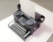 typewriter popup  card with keys. Blank paper