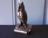 Owl standing on books metal figurine