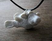 Cow fish porcelain pendant
