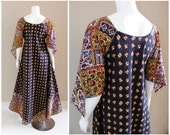 Vintage India cotton print maxi dress with extra wide skirt and angelwing sleeves. 1960s.