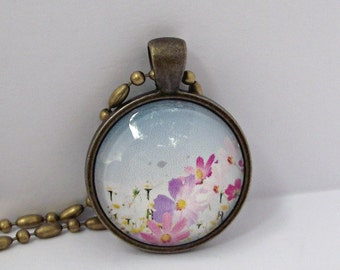 SALE. Meadow flowers pendant. Antique brass. Pretty and feminine. Spanish sky