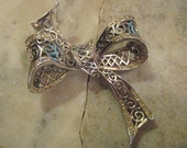 Vintage Brooch: 1940s Silver Plated Filigree Ribbon Bow Shaped Pin, Clear Rhinestone Edge Trim, Designer Quality, 2.5 x 2.5""