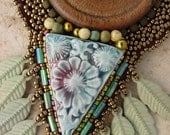 Wooden button and feathers Necklace